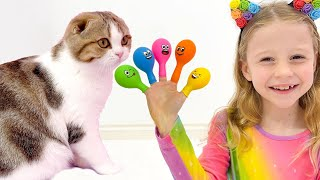 Nastya pretends to play and teaches kittens colors