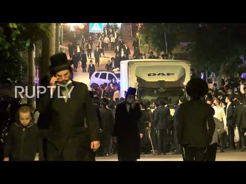 Israel: Thousands Of Orthodox Jews Defy COVID Restrix In Rabbi Funeral