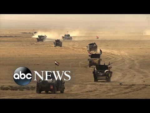 Iraqi Forces Assault Mosul District