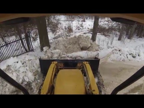 Clearing Snow With The Huge Loader Bucket And Stirring Leaves