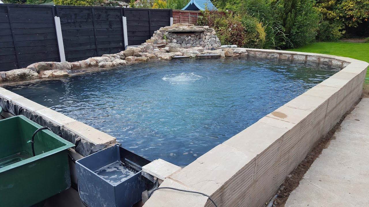 Raised koi pond build 2015 water finally in doovi for How to build a koi pond on a budget
