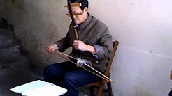 AFRICASIAEURO.COM/YOUTUBE - playing the ERHU in China Jiangxi province