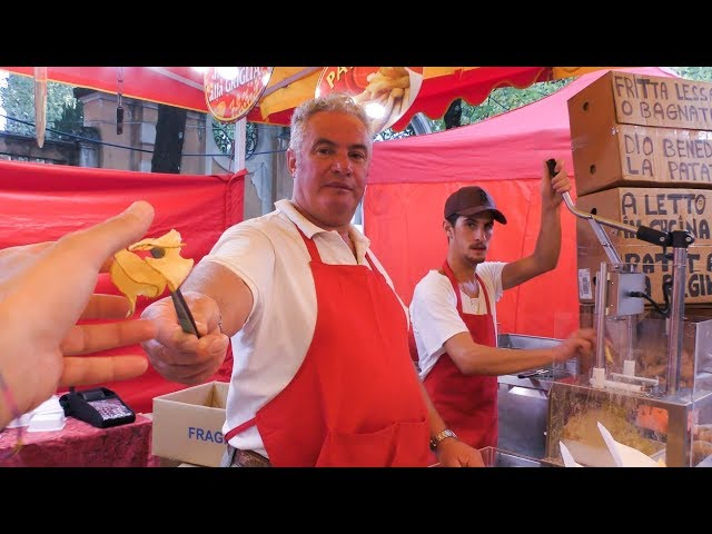 Italy Street Food. Twister Chips Machine and Grilled Cob