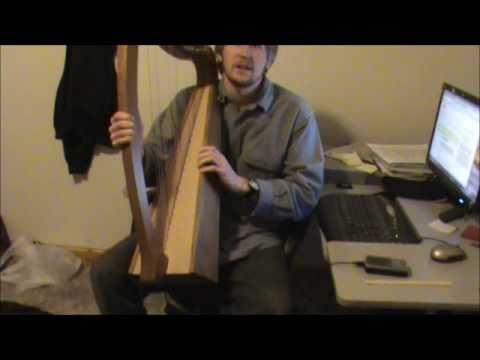 a beginner playing a harp