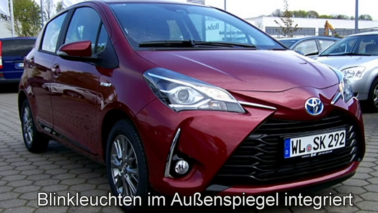 toyota yaris comfort hybrid 0a330110 tokio rot perleffekt autohaus s k buchholz youtube. Black Bedroom Furniture Sets. Home Design Ideas