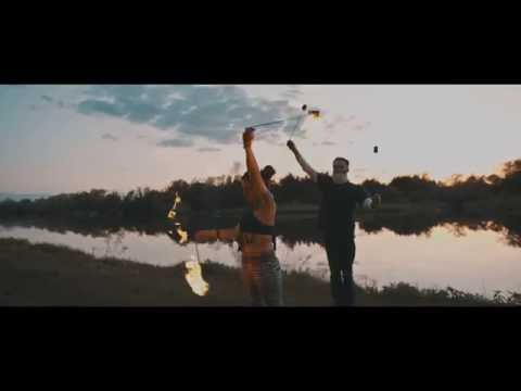 Couple Spinning Fire at Sunset [Last Ember Entertainment]
