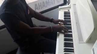 Musiq Man playing on the paino