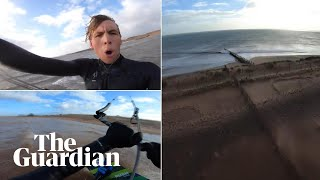 Kitesurfer makes staggering 200-metre leap over sand spit in Devon