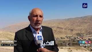 تشققات وحفر وانهيارات تهدد سلامة المواطنين والسائقين على طريق عيمة في الطفيلة - (22-4-2018)