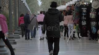 Explanada Promenade with people and street vendors in Alicante, Spain