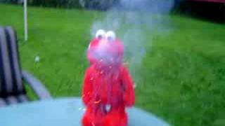 Tickle me emlo with a mouth full of fire crackers funny