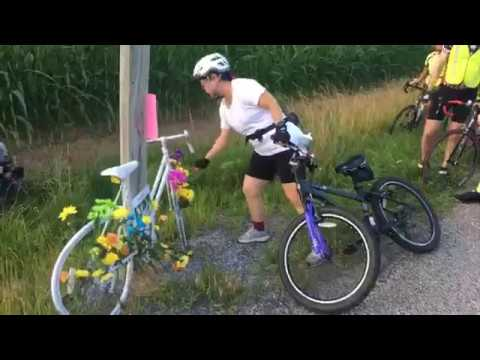 Bicyclists ride and present ghost bike in honor of Taylor Childs