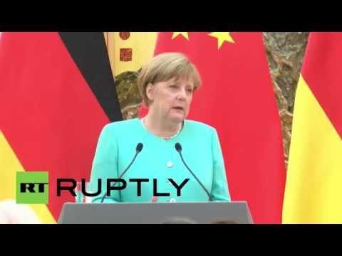 China: Merkel, Li Keqiang downplay tensions over China-Europe trade market