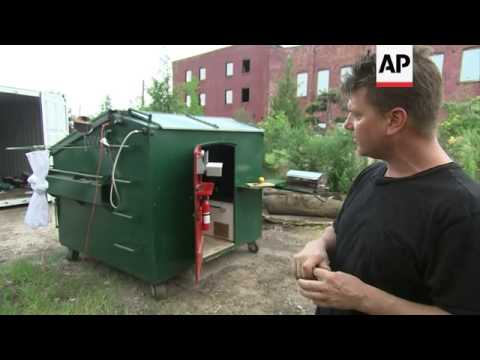 Artist turns dumpster into home from home