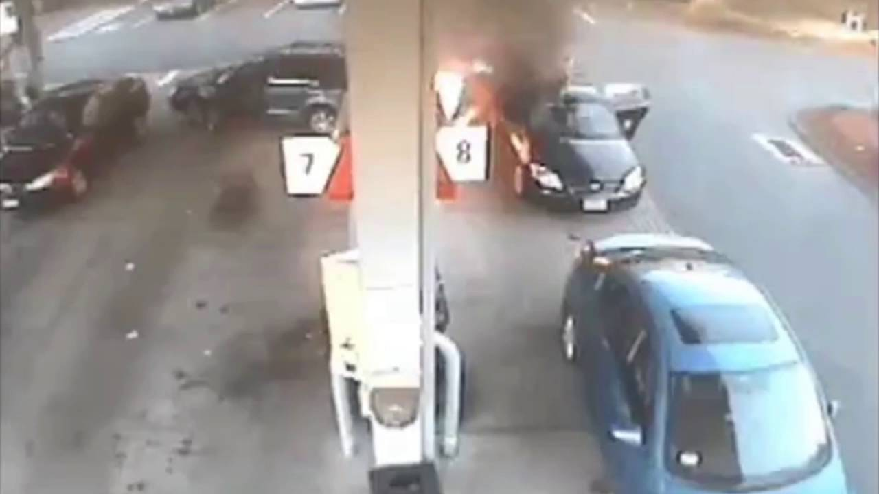 Heart stopping moment mum rescues children from flaming car after car crashes into petrol station