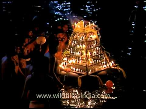 Devotees releasing lighted lamps to river pampa