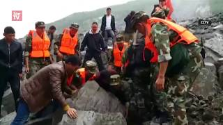 Over 100 people buried in landslide in southwest China