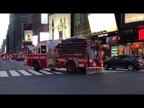 FDNY ENGINE 26 TAKING UP FROM A EMS CALL ON WEST 42ND STREET IN TIMES SQUARE, MANHATTAN, NEW YORK.
