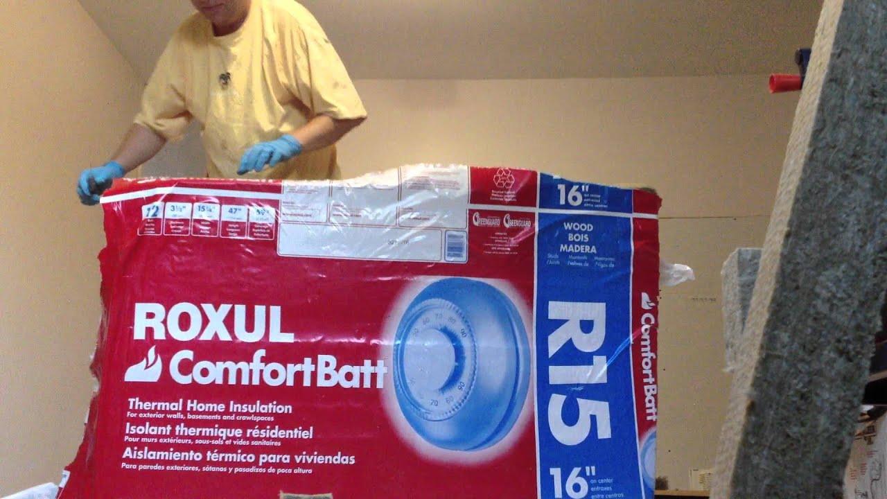 Opening A Bag Of Roxul Comfortbatt Stone Wool Insulation