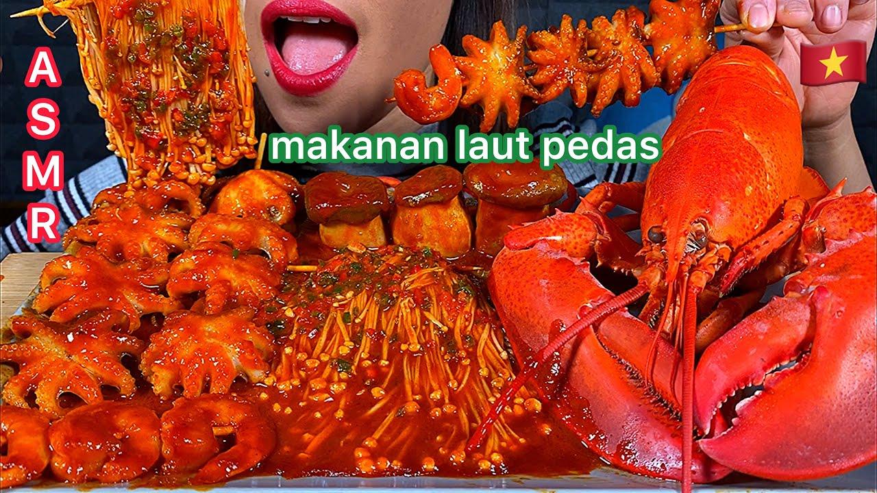 Eating Spicy Seafood Boil Lobster Octopus Shrimps Mushrooms