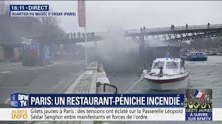 Des pompiers tentent d'éteindre un incendie sur une péniche, dans le quartier du musée d'Orsay