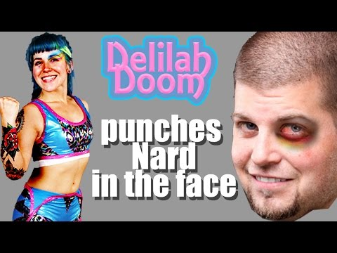 Nard gets puched in the face by Delilah Doom