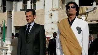 Muammar Gaddafi and Nicolas Sarkozy