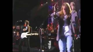 Axl Rose and Bruce Springsteen perform