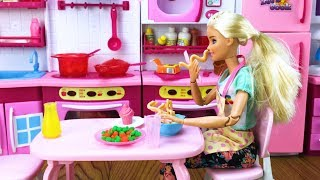 Barbie went into the kitchen hungry, took out food materials from t...