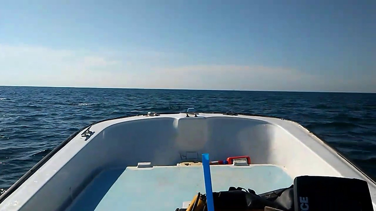 Running off shore 14 foot mckee craft - YouTube
