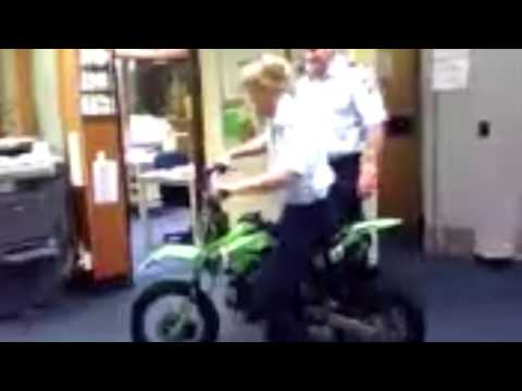AUSTRALIAN POLICE LADY ON STOLEN MOTORBIKE IN POLICE STATION