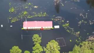 Trump visits North Carolina as rivers swell after Florence