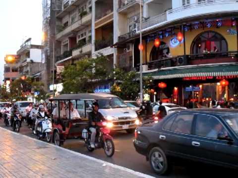 Traffic on Sisowath Quay Road, Phnom Penh Cambodia.