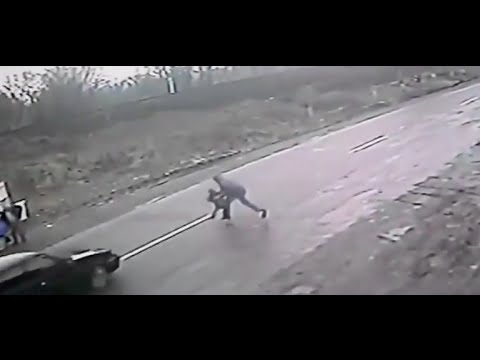 Dramatic Footage Shows Hero Dad Save Son From Speeding Car
