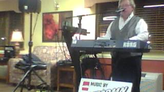 """Stormn' Normn"" performs ""Because He Lives"" by Bill Gaither."