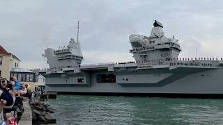 HMS Queen Elizabeth Aircraft Carrier arriving at Portsmouth Harbour