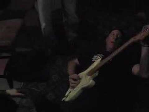 Guitarist falls off table doing solo