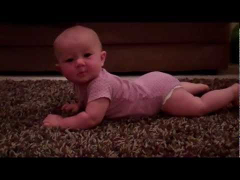 Little baby trying to crawl... super cute