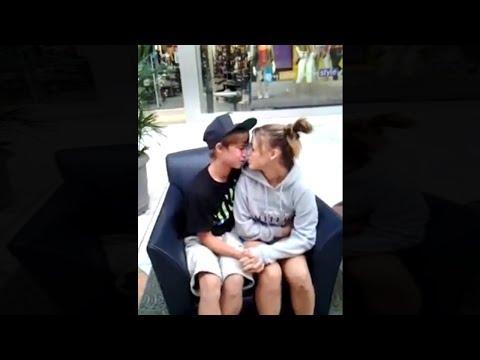 kids have an awkward kiss in public..