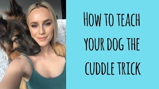 How to teach your dog the cuddle trick