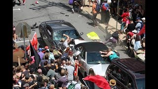 CHARLOTTESVILLE, VA a car PLOWS into a crowd of protesters. GRAPHIC Collection of Footage.