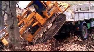 unloading john deere 450 saurer 5dm
