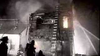 Wooden Building Collapses From Fire