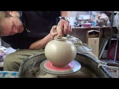 Throwing a spherical round Korean type pottery Vase on the wheel