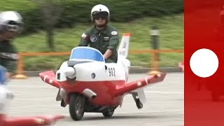 Plane-shaped scooters amuse staff members of Japan