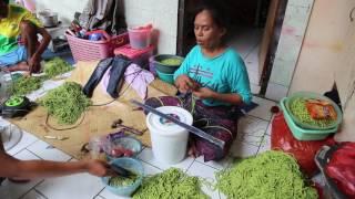 Fair trade artisan making beaded jewelry