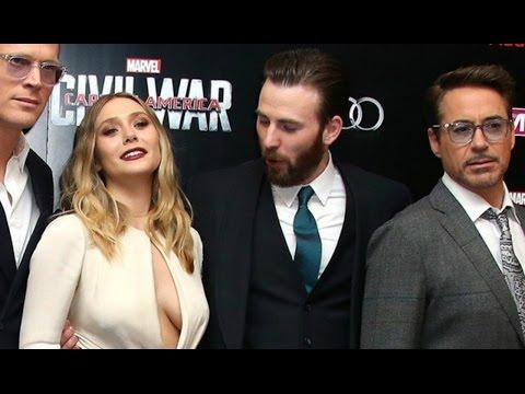 Chris Evans Caught Staring At Elizabeth Olsen's Chest At 'Captain America' Premiere