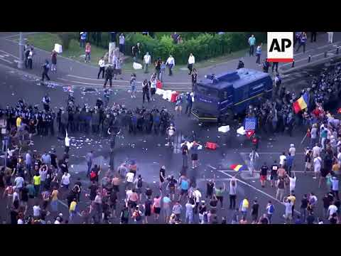 Water canon deployed during clashes at Romanian protest rally
