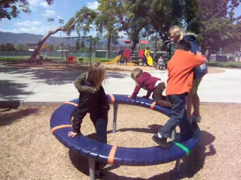 Kids At The Park In Spinning Wheel Youtube