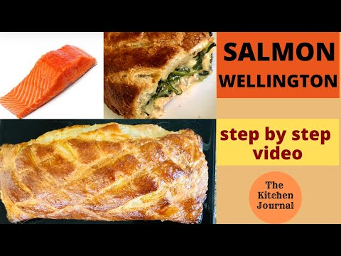 Salmon Wellington with Spinach and cheese.Salmon fillet wrapped in puff pastry gives a crunchy crust